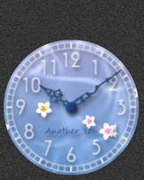 花が静かに水面に流れるアナログ時計です。触れるか分針が動くとさざ波がたちます。